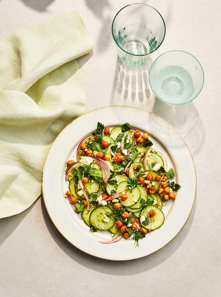 """<p><strong>Recipe: <a href=""""https://www.southernliving.com/recipes/cucumber-chickpea-salad-feta-mint-vinaigrette"""" rel=""""nofollow noopener"""" target=""""_blank"""" data-ylk=""""slk:Cucumber-Chickpea Salad with Feta-Mint Vinaigrette"""" class=""""link rapid-noclick-resp"""">Cucumber-Chickpea Salad with Feta-Mint Vinaigrette</a></strong></p> <p>The homemade vinaigrette for this cucumber salad calls for 3/4 cup of fresh mint, plus other fresh herbs so it's a great recipe to showcase your homegrown ingredients. </p>"""