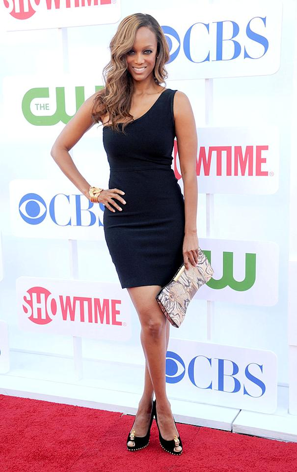 "At the TV Critics Association <a target=""_blank"" href=""http://tv.yahoo.com/photos/cbs-tca-summer-press-tour-2012-slideshow/"">summer tour party on Sunday evening</a>, Tyra Banks proved that the perfect accessories can elevate even the most basic of little black dresses. Upon arriving at the star-studded soiree, the ""Top Model"" hostess with the mostest popped a pose in a chic, one-shouldered cocktail frock, which she paired with a Wonder Woman-esque cuff, swirled clutch, and skull-adorned Alexander McQueen peep-toe pumps. For all the haters out there who've given Tyra flack for her figure over the years, look who's laughing now! (7/29/2012)<br><br><a target=""_blank"" href=""http://tv.yahoo.com/photos/america-s-next-top-model-meet-the-cycle-19-contestants-slideshow/"">'America's Next Top Model: College Edition' ... Meet the Coeds!</a>"