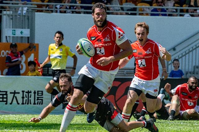 Grant Hattingh scores a try for the Sunwolves on their way to victory against the Western Stormers (AFP Photo/Philip FONG)