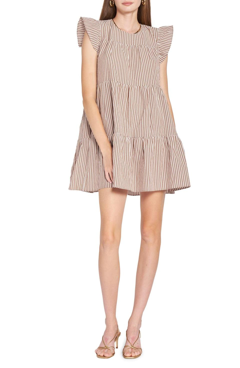 <p>On hotter fall days, this <span>En Saison Striped Babydoll Tiered Cotton Minidress</span> ($84) is the perfect option. Pair it with simple sneakers.</p>