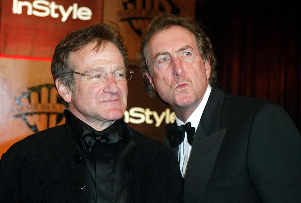 BEVERLY HILLS - JANUARY 25: Actors Robin Williams and Eric Idle attend the InStyle Magazine and Warner Bros. Studios post Golden Globe party at Palm Court, Beverly Hills Hotel on January 25, 2004 in Beverly Hills, California.  (Photo by Frazer Harrison/Getty Images)