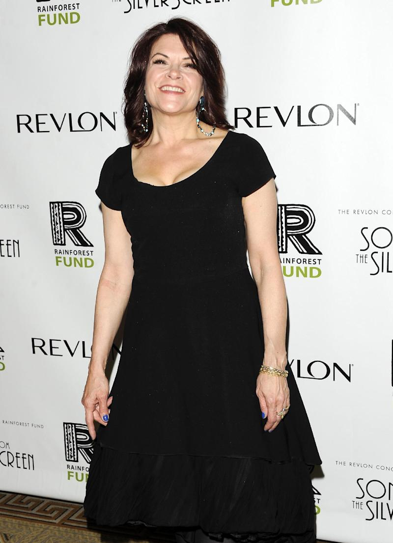 FILE - This April 3, 2012 file photo shows singer Rosanne Cash at the Revlon Concert for the Rainforest Fund dinner and auction in New York. Cash has been a New Yorker for two decades now. Her latest project is taking her out of the city. She's preparing a new album of songs about the American South, and did a lot of traveling with her husband, John Leventhal to get ideas. (AP Photo/Evan Agostini, file)