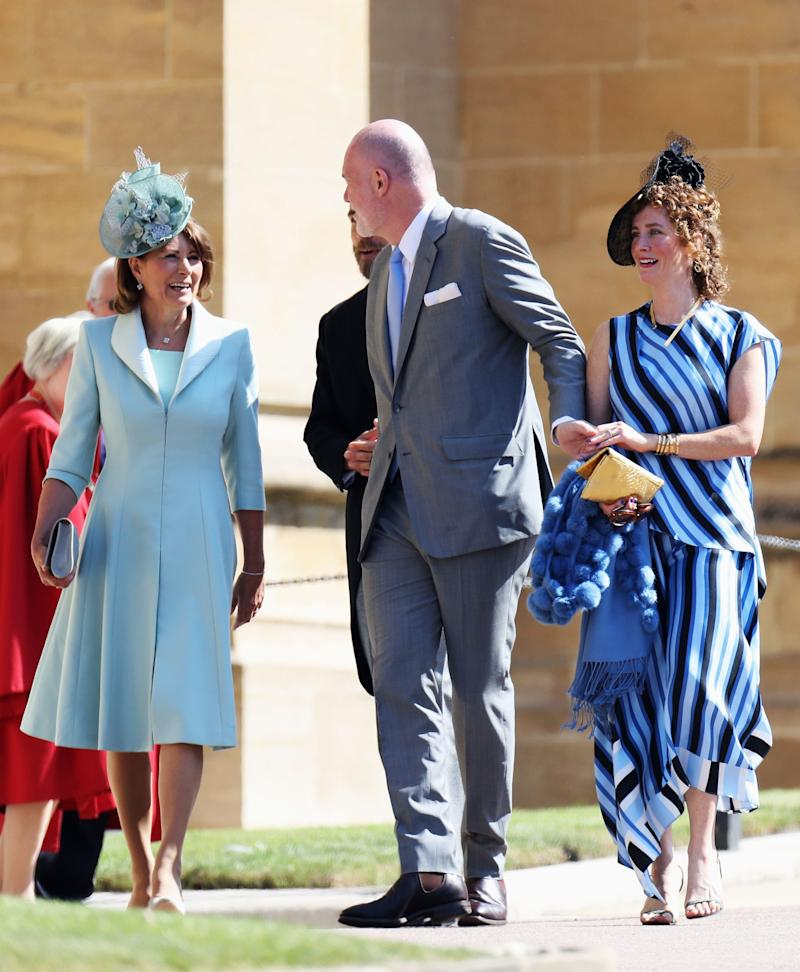 Carole Middleton, Paddy Harverson and Mel Harverson arrives at the wedding of Prince Harry to Ms Meghan Markle at St George's Chapel, Windsor Castle on May 19, 2018 in Windsor, England.
