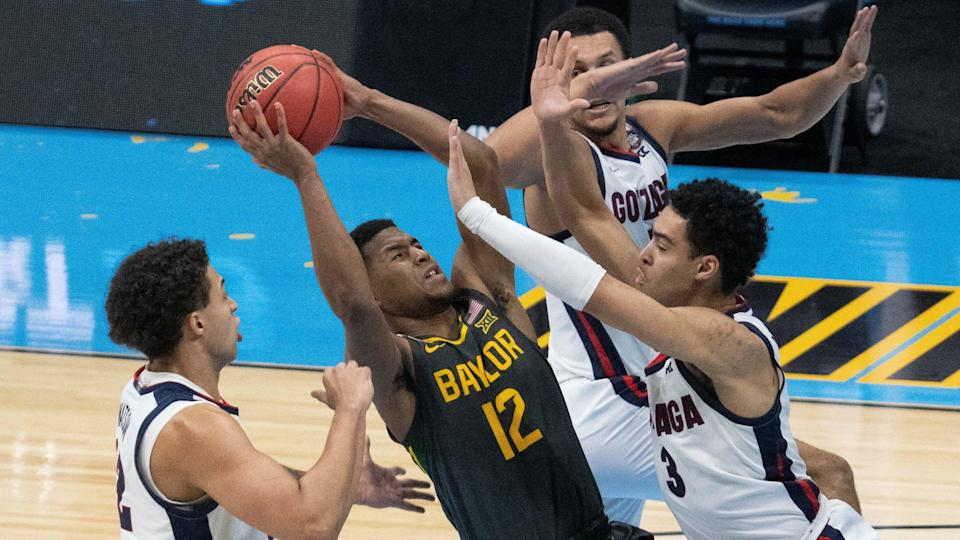 Apr 5, 2021; Indianapolis, IN, USA; Baylor Bears guard Jared Butler (12) attempts t shoot the ball against the Gonzaga Bulldogs in the second half during the national championship game in the Final Four of the 2021 NCAA Tournament at Lucas Oil Stadium. Mandatory Credit: Kyle Terada-USA TODAY Sports ORG XMIT: IMAGN-446986 ORIG FILE ID:  20210409_kkt_st3_210.jpg