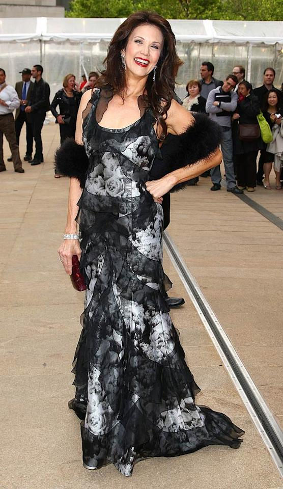 "She may be 57, but former ""Wonder Woman"" star Lynda Carter proved that she's still out of this world in a Carolina Herrera rose print gown, faux fur shrug, and ruby red lips at the 69th Annual American Ballet Spring Gala. Andrew H. Walker/<a href=""http://www.gettyimages.com/"" target=""new"">GettyImages.com</a> - May 18, 2009"