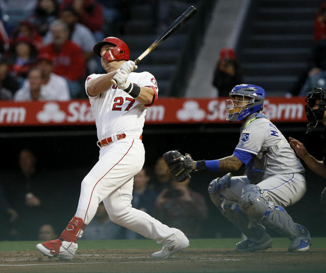 Los Angeles Angels' Mike Trout follows through on a solo home run next to Kansas City Royals catcher Martin Maldonado during the first inning of a baseball game in Anaheim, Calif., Saturday, May 18, 2019. (AP Photo/Alex Gallardo)