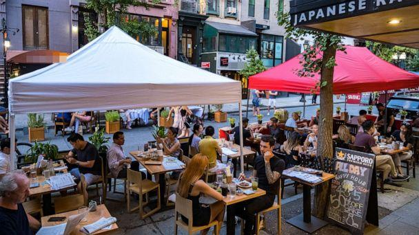 PHOTO: People dine al fresco, or open air, in Hell's Kitchen on July 21, 2020 in New York City. (Jeenah Moon/Getty Images)