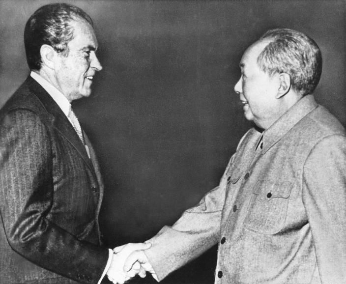** FILE** In this Feb 21, 1972 file photo, U.S. President Richard M. Nixon, left, shakes hands with Chinese communist party leader Chairman Mao Zedong during Nixon's groundbreaking trip to China, in Beijing. Forged in absolute secrecy at the height of the Cold War 30 years ago, the diplomatic ties established between the United States and China were meant to balance out the Soviet threat. (AP Photo/File)
