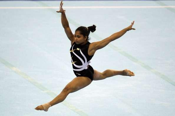 GUANGZHOU, CHINA - NOVEMBER 14: Dipa Karmarkar of India competes in the Women's Team Final floor discipline at the Asian Games Town Gymnasium during day two of the 16th Asian Games Guangzhou 2010 on November 14, 2010 in Guangzhou, China. (Photo by Hannah Peters/Getty Images)