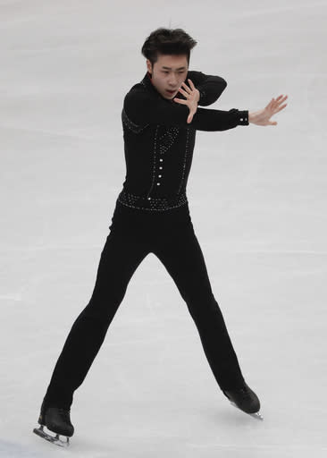 Boyang Jin of China performs during men's short program at the Figure Skating World Championships in Assago, near Milan, Thursday, March 22, 2018. (AP Photo/Antonio Calanni)