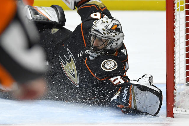 Anaheim Ducks goaltender Ryan Miller stops a shot during the first period of the team's NHL hockey game against the Washington Capitals on Friday, Dec. 6, 2019, in Anaheim, Calif. (AP Photo/Mark J. Terrill)