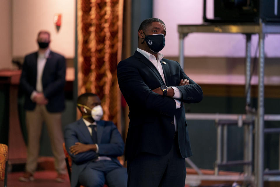 "Rep. Cedric Richmond, D-La., right, watches as Democratic presidential candidate former Vice President Joe Biden appears on a ""Zoom with Oprah Winfrey"" virtual show at The Queen theater in Wilmington, Del., Wednesday, Oct. 28, 2020. (AP Photo/Andrew Harnik)"