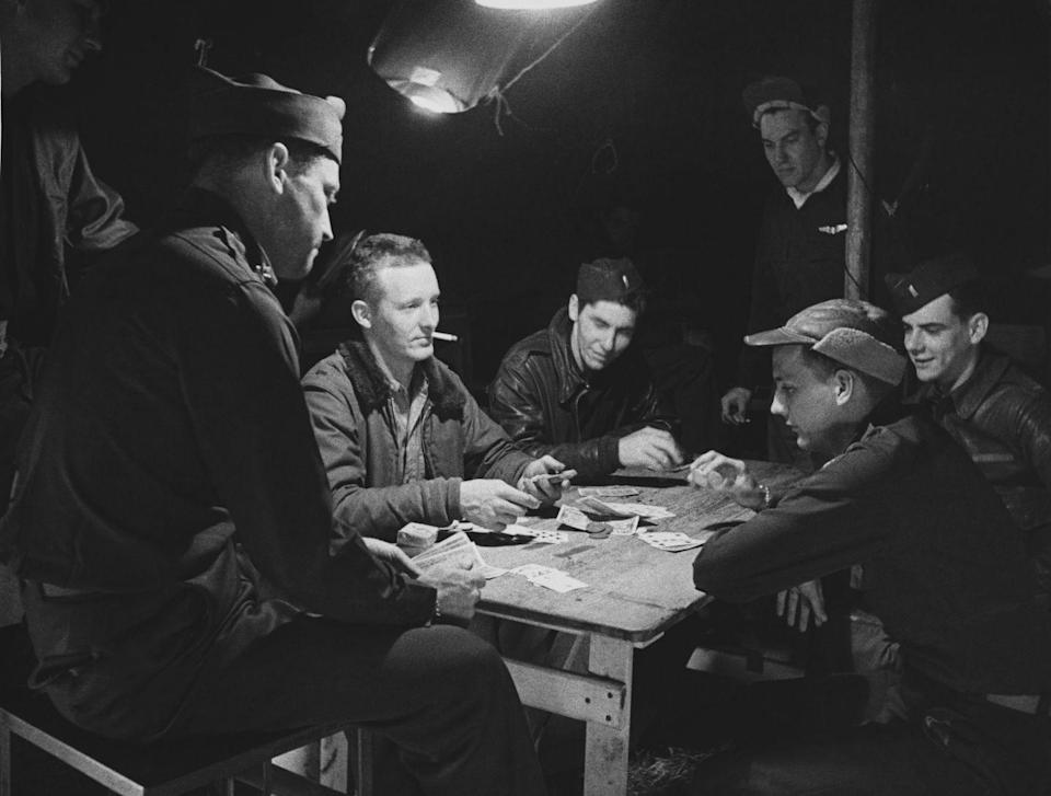 """<p>During World War II, the U.S. and Britain snuck Allied prisoners of war escape maps using <a href=""""https://www.popularmechanics.com/military/a34994267/wwii-playing-card-escape-map/"""" rel=""""nofollow noopener"""" target=""""_blank"""" data-ylk=""""slk:playing cards"""" class=""""link rapid-noclick-resp"""">playing cards</a>. The papers, containing detailed escape routes, were hidden in between the layers of cards. The Geneva Convention stated Christmas care packages were allowed to be delivered to POWs, which is how the decks of cards went undetected. </p>"""