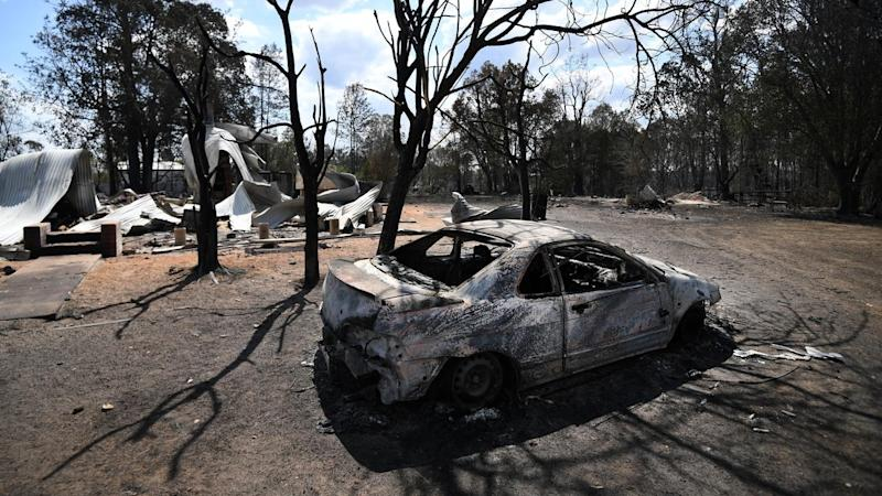 An elderly couple has died and dozens of properties destroyed in bushfires in northern NSW