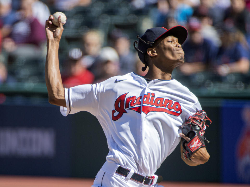Cleveland Indians starting pitcher Triston McKenzie delivers against the Chicago White Sox during the first inning of a baseball game in Cleveland, Sunday, Sept. 26, 2021. (AP Photo/Phil Long)