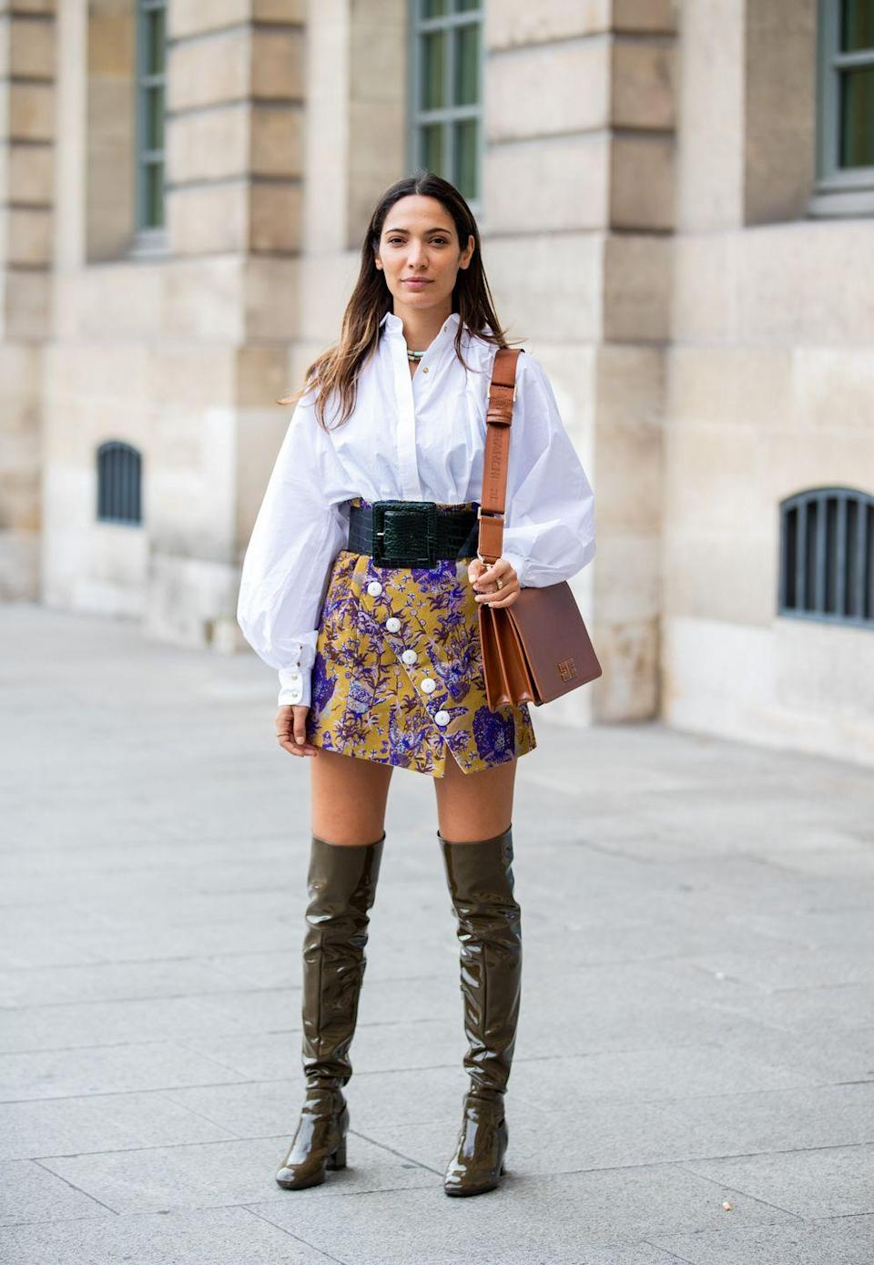 <p>Ditch a black pair in favor of patent leather olive-green ones, and be creative with your color combinations. This skirt, top, belt, and bag situation features so many other hues, but they all go together so perfectly. </p>