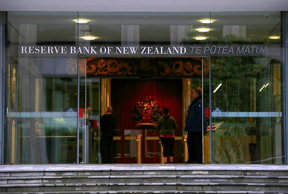A security guard stands in the main entrance to the Reserve Bank of New Zealand located in central Wellington, New Zealand, July 3, 2017. Picture taken July 3, 2017.   REUTERS/David Gray