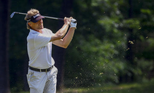 Bernhard Langer of Germany hits an approach shot on the second hole during the final round of the Regions Tradition golf tournament, Sunday, May 20, 2018, in Birmingham, Ala. (AP Photo/Butch Dill)
