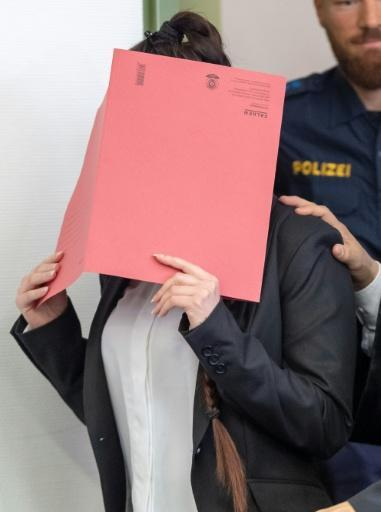 German woman Jennifer W who joined the Islamic State group hides her face as she arrives in court for the opening of her trial on April 9, 2019 in Munich, southern Germany