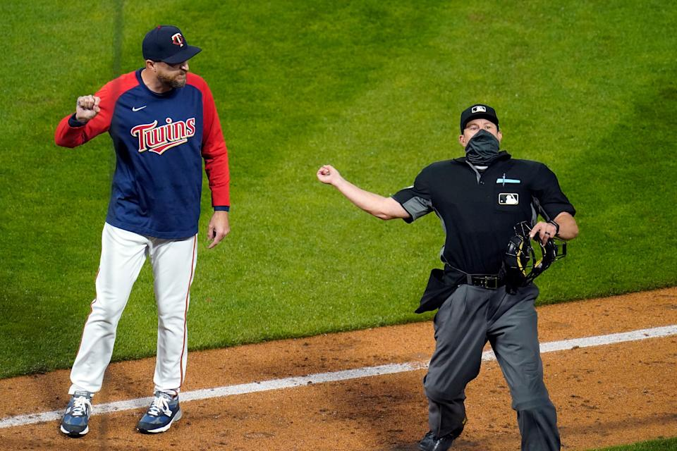 Twins manager Rocco Baldelli, left, is ejected by home plate umpire Jim Reynolds after complaining about pitcher Tyler Duffey being ejected.