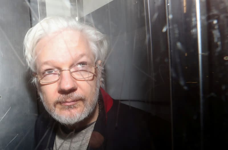 Coronavirus forces delay in U.S. extradition case against Assange