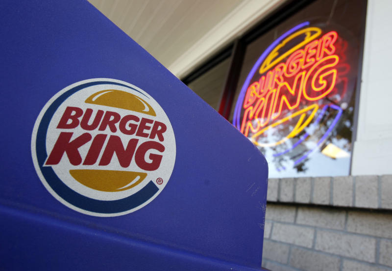 FILE - This Aug. 23, 2010 file photo shows company logos on display at a Burger King restaurant in Mountain View, Calif. The hamburger chain, which is revamping its menu in an attempt to revive its struggling business, announced Tuesday, April 3, 2012 it will list its stock on the New York Stock Exchange. The company says its international growth plans will benefit from better visibility as a public company. (AP Photo/Paul Sakuma, File)