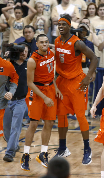 Syracuse's Tyler Ennis (11) celebrates with C.J. Fair (5) after hitting a 3-point shot with less than a second remaining in an NCAA college basketball game against Pittsburgh on Wednesday, Feb. 12, 2014, in Pittsburgh. Syracuse won 58-56. (AP Photo/Keith Srakocic)
