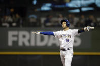 Milwaukee Brewers' Ryan Braun gestures after hitting a double during the first inning of the team's baseball game against the Pittsburgh Pirates on Friday, Sept. 20, 2019, in Milwaukee. (AP Photo/Aaron Gash)