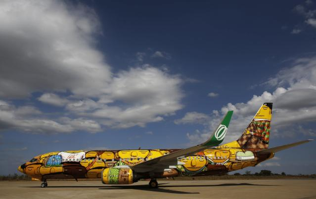 "The Boeing 737 aircraft of Brazilian airline Gol, which will travel with the Brazilian national soccer team during the 2014 World Cup, is presented to the media at Confins International Airport, in Belo Horizonte May 27, 2014. The aircraft was painted by Brazilian artists, twin brothers who go by the name ""Os Gemeos"". Belo Horizonte is one of the host cities for the 2014 World Cup in Brazil. REUTERS/Nacho Doce (BRAZIL - Tags: SPORT SOCCER WORLD CUP SOCIETY TRANSPORT)"