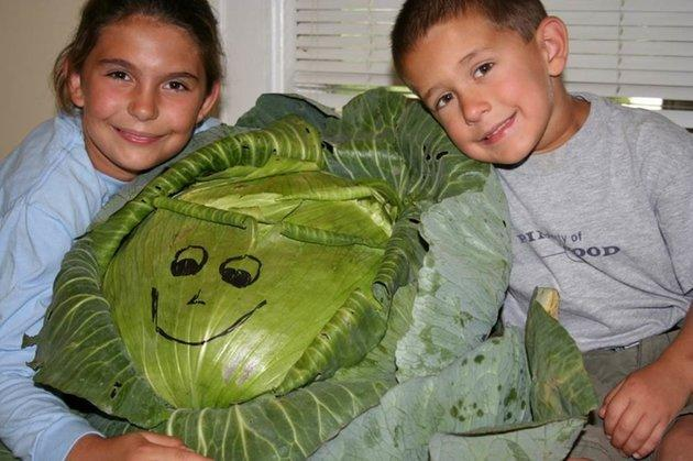 Katie and her little brother with the cabbage.