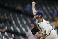 Milwaukee Brewers' Brandon Woodruff pitches during the first inning of a baseball game against the St. Louis Cardinals Tuesday, Sept. 21, 2021, in Milwaukee. (AP Photo/Aaron Gash)