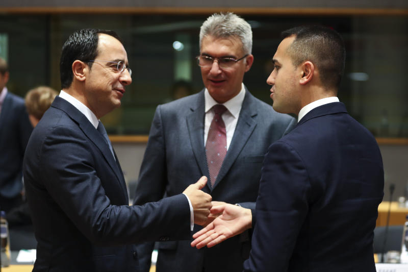 Italian Foreign Minister Luigi Di Maio, right, talks to Cyprus' Foreign Minister Nicos Christodoulides, left, and Malta's Foreign Minister Carmelo Abela during an European Foreign Affairs Ministers meeting at the Europa building in Brussels, Monday, Nov. 11, 2019. European Union foreign ministers are discussing ways to keep the Iran nuclear deal intact after the Islamic Republic began enrichment work at its Fordo power plant. (AP Photo/Francisco Seco)