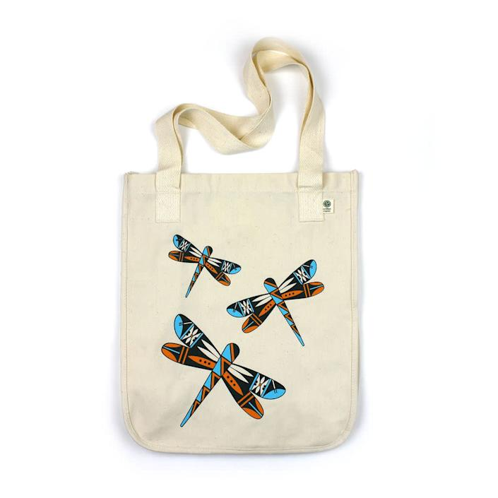 """This Seattle-based company takes an artist-centric approach to 100 percent Native-designed products like its tote bags. The Dancing Dragonflies tote comes from Acoma Pueblo artist Michelle Lowden, who found inspiration in her dad&rsquo;s cottonwood sculptures and the cultural significance of the dragonfly; the Acoma Pueblo view the dragonfly as a positive sign or an indicator of good luck. Lowden also represents one of Eighth Generation&rsquo;s Inspired Natives Project collaborators. &lt;br&gt;&lt;br&gt;<strong><a href=""""https://eighthgeneration.com/collections/bags/products/dragonflies-tote-bag"""" rel=""""nofollow noopener"""" target=""""_blank"""" data-ylk=""""slk:Eighth Generation Tote Bag,"""" class=""""link rapid-noclick-resp"""">Eighth Generation Tote Bag,</a> $24</strong>"""