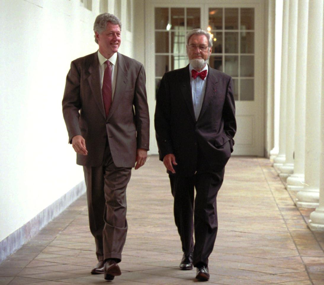 President Bill Clinton and former Surgeon General C. Everett Koop walk along the Colonnade to the Oval Office at the White House Aug.17, 1994. Clinton's push for passage of health care reform has been sidetracked by efforts to get the crime bill passed. (AP Photo/Wilfredo Lee)