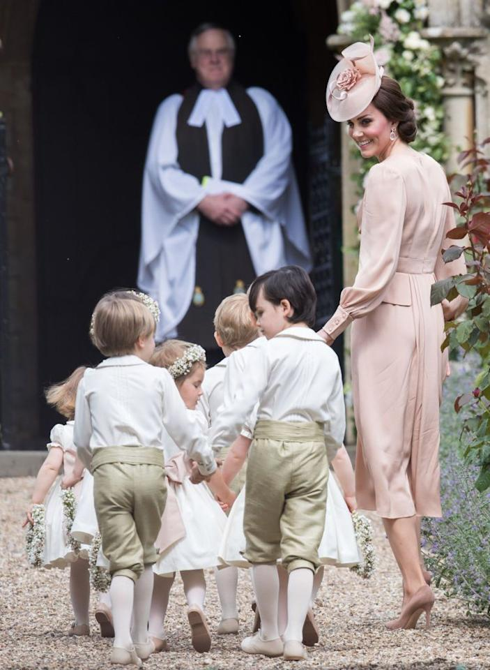 """<p>For <a rel=""""nofollow"""" href=""""http://www.townandcountrymag.com/the-scene/weddings/a9562354/pippa-middleton-wedding-dress-news/"""">Pippa Middleton's wedding</a> in Berkshire on May 20<span></span>, the Duchess of Cambridge wore a pink Alexander McQueen dress, the same designer she wore to her own wedding in 2011.</p>"""