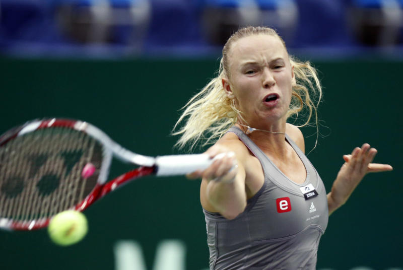 Denmark's Caroline Wozniacki returns a ball to Sweden's Sofia Arvidsson during a semifinal match at the Kremlin Cup tennis tournament in Moscow, Russia, Saturday, Oct. 20, 2012. (AP Photo/Misha Japaridze)