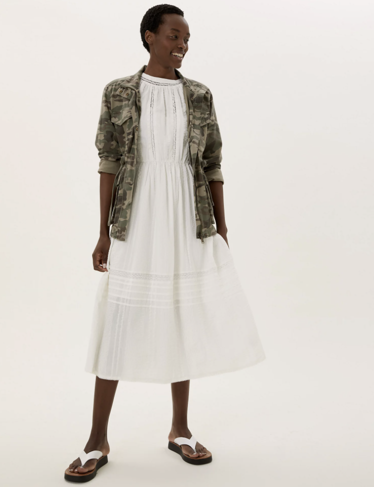 The white M&S dress and camo jacket are now available to buy from M&S. (Marks & Spencer)