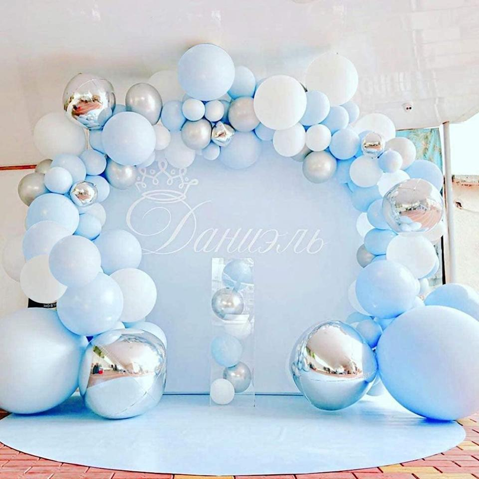 <p>The <span>141-Piece Pastel Blue and Silver Balloon Garland Kit</span> ($21) is so stunning! </p>
