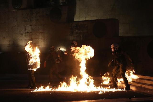 <p>A masked demonstrator throws a petrol bomb to riot police outside the parliament building as Greek lawmakers vote on the latest round of austerity Greece has agreed with its lenders, in Athens, Greece, May 18, 2017. (Photo: Costas Baltas/Reuters) </p>