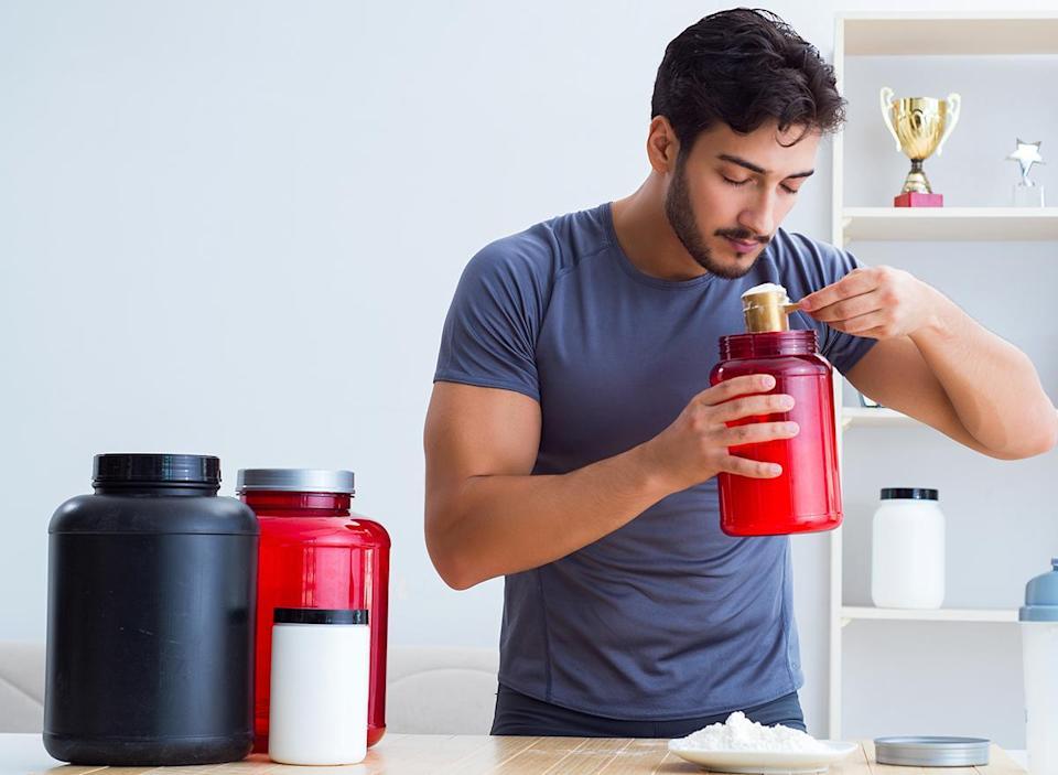 man using protein powder