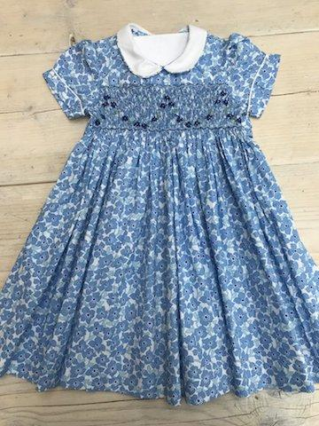 """<p><em><a rel=""""nofollow"""" href=""""https://littlealicelondon.com/collections/peter-pan-collar-smocked-dresses/products/periwinkle?variant=40049733268"""">Little Alice London</a>, £45</em> </p>"""