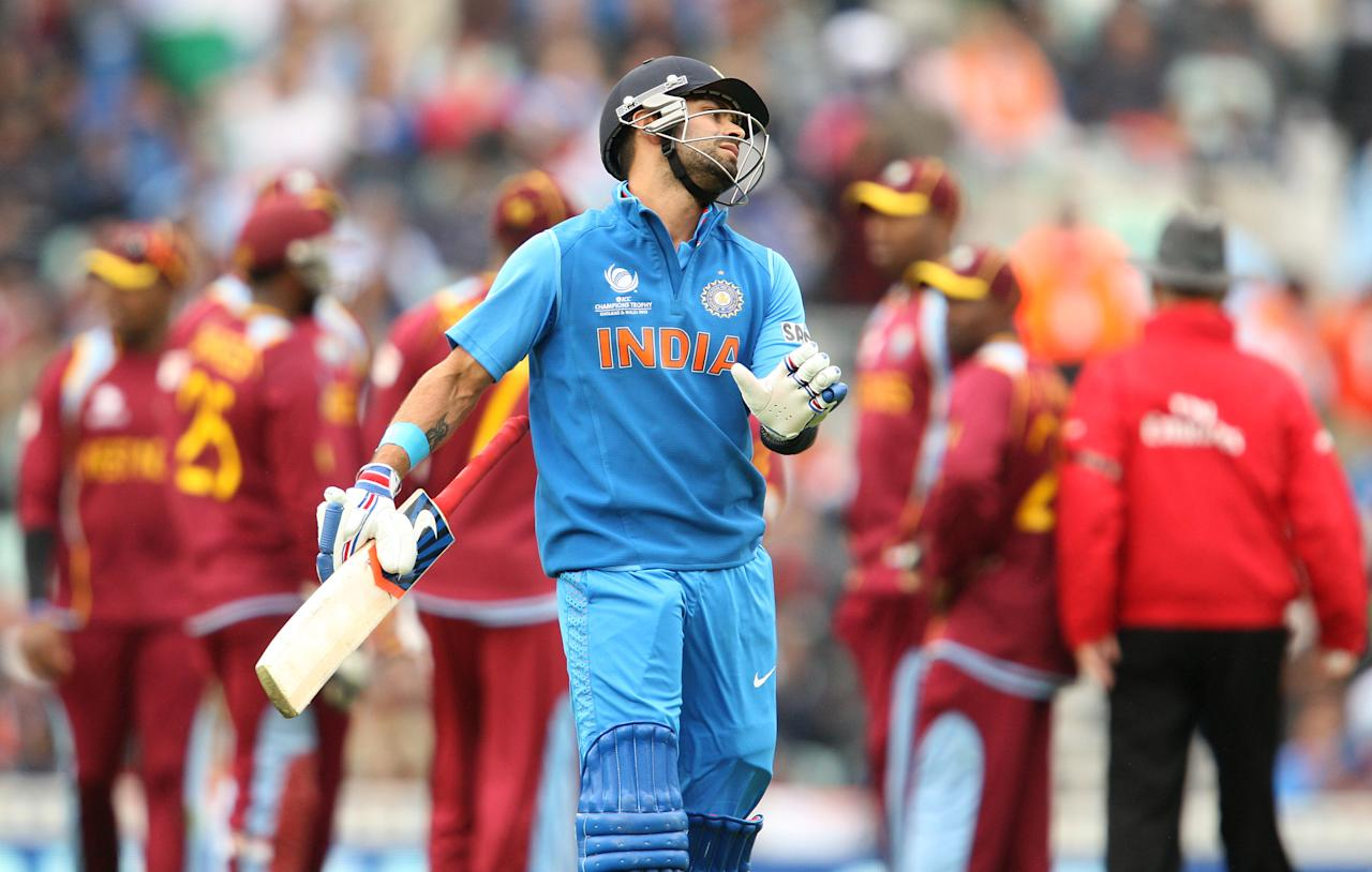 India's Virat Kohli reacts after being dismissed during the ICC Champions Trophy match at the Kia Oval, London.