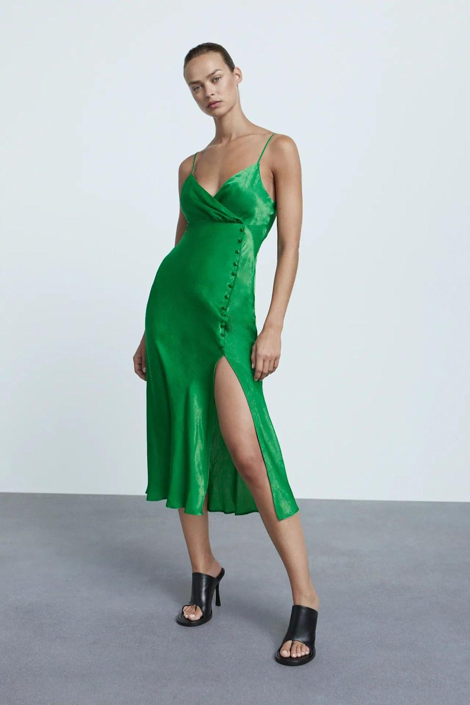 <p>This <span>Zara Buttoned Slip Dress</span> ($46) is striking and sexy. It comes in a few colors, but we love the green for fall and winter.</p>