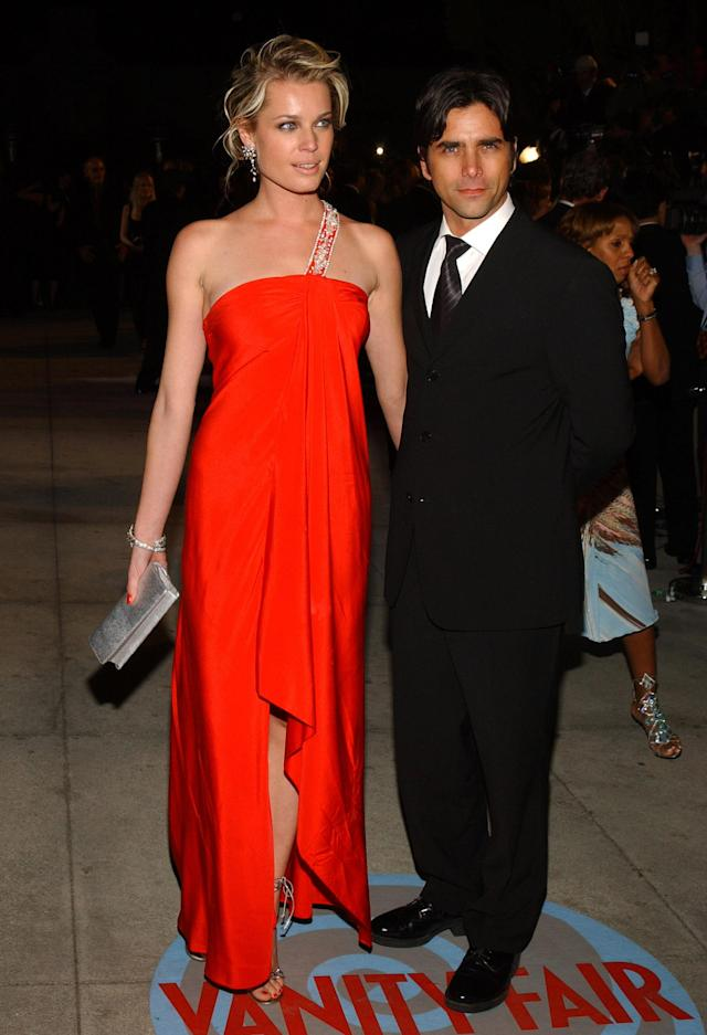 Rebecca Romijn and John Stamos in February 2004. (Photo: Getty Images)