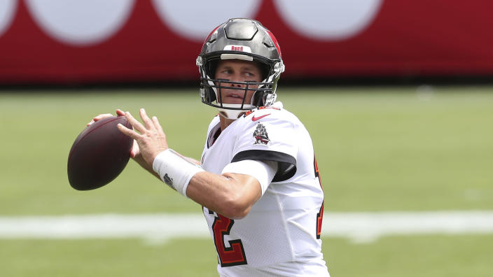 Tampa Bay Buccaneers quarterback Tom Brady will have home fans in the stands beginning in October. (AP Photo/Mark LoMoglio)