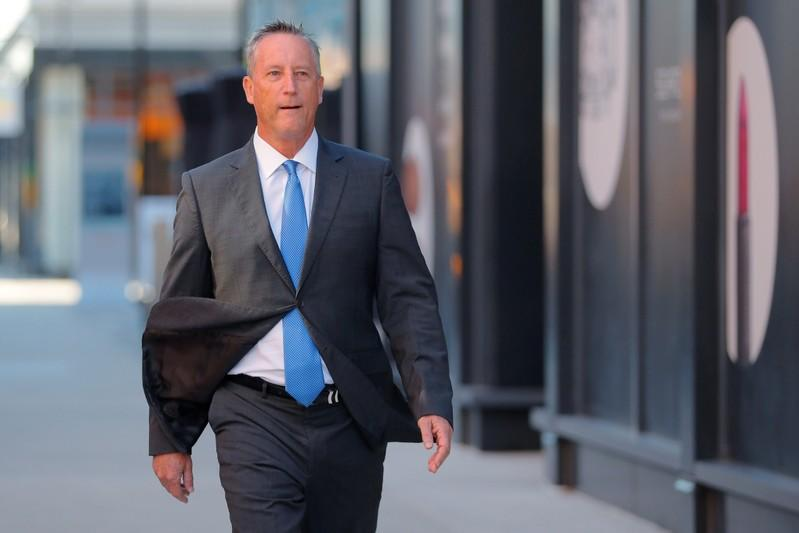 Martin Fox passes the federal courthouse before entering a plea in Boston