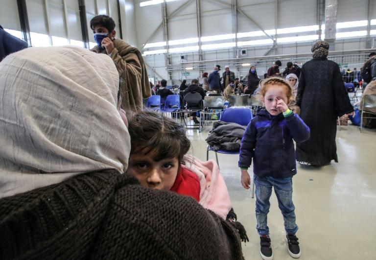 The Afghan evacuees have had to get past Taliban checkpoints before being flown to Qatar or Kuwait, and then on to Germany (AFP/Armando BABANI)