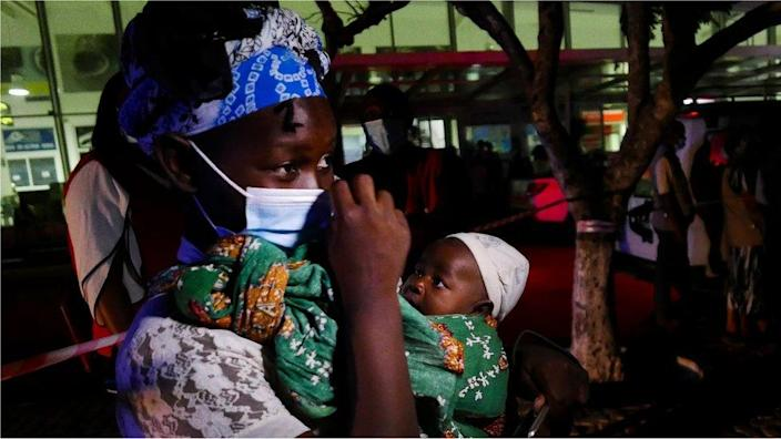 Aida Cisto, a 29 years old woman displaced from Palma, who spent 4 days hidden in the forest with her one month old daughter Jacinta da Esperanca, arrives at Pemba Airport, Mozambique, 30 March 2021.