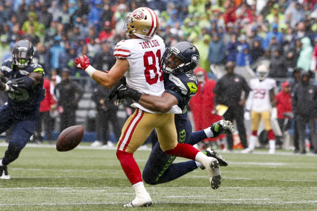 <p>Seattle Seahawks outside linebacker K.J. Wright (50) breaks up a pass intended for San Francisco 49ers wide receiver Trent Taylor (81) during the second quarter at CenturyLink Field. Mandatory Credit: Joe Nicholson-USA TODAY Sports </p>