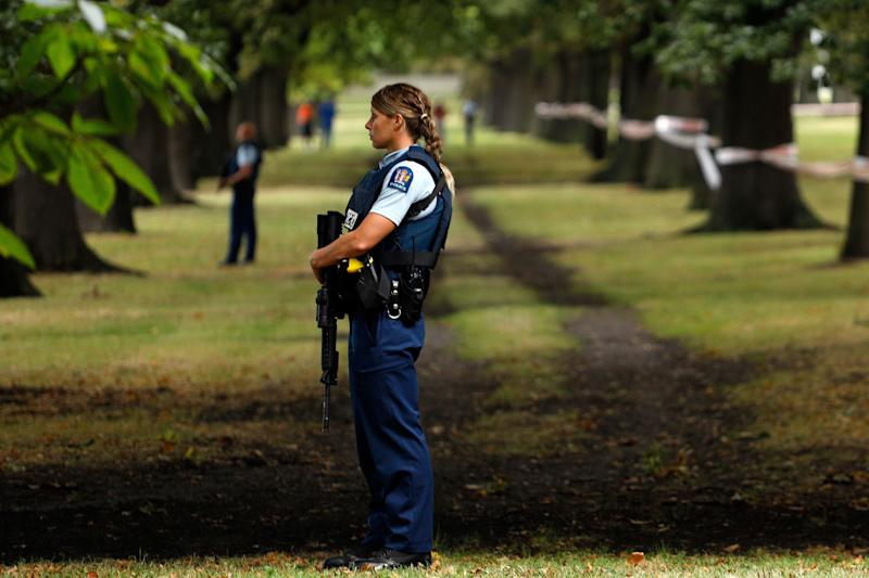 Police officers guard the area close to the Masjid al Noor mosque after a shooting in Christchurch on March 15, 2019.